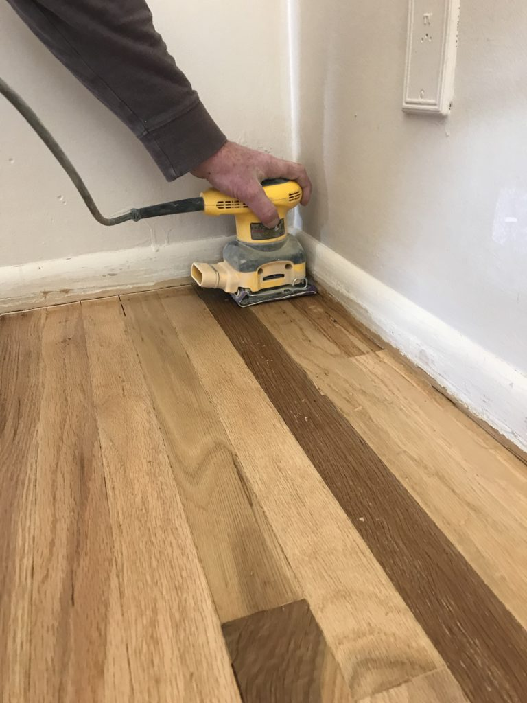sanding wood floors to prepare