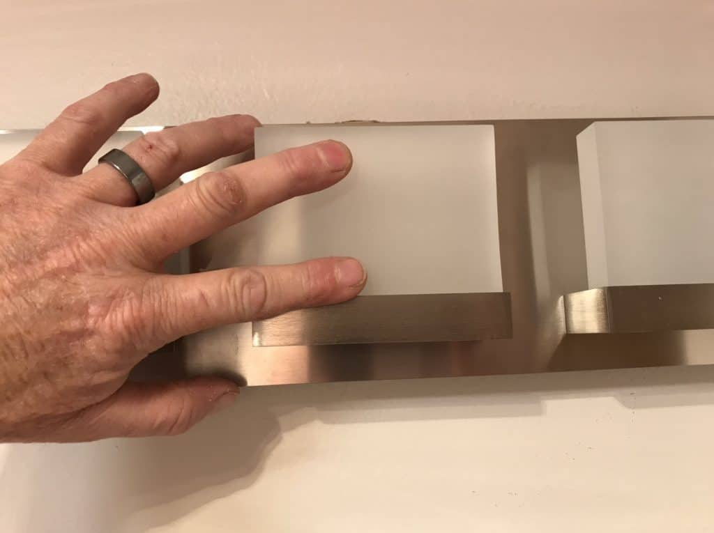 Install new bathroom light vanity